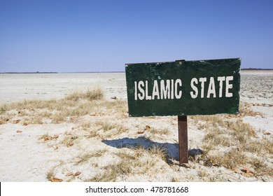 dark sign in the desert with the words islamic state in white letters. Political concept concerning terrorism and the war in Syria and Iraq