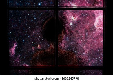 Dark silhouette of child alone in isolation behind glass door. Abstract image of sadness, apathy, depression, melancholy. Many stars and nebula in dark room. Elements of this image furnished by NASA.