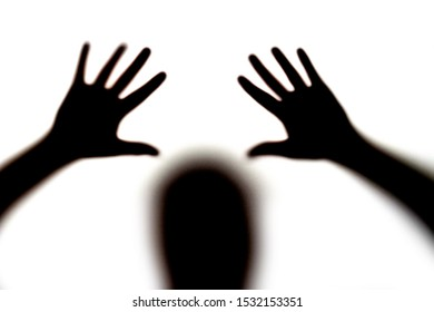 Dark silhouette of female hands and head on a white background, concept of fear