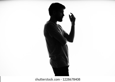 dark silhouette of a man side view