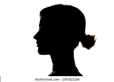Dark silhouette profile of young girl on white background, concept of anonymity