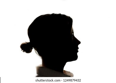 Dark silhouette of a young girl on a white background, the concept of anonymity
