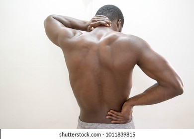 Dark skin African hand with back pain waist pain and neck pain concept isolated on white background