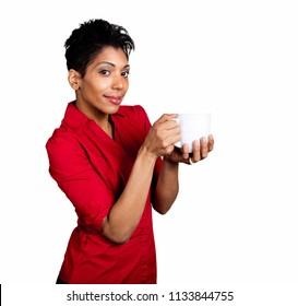 Dark Skinned Hispanic woman holding a white coffee mug on a pure white background isolated