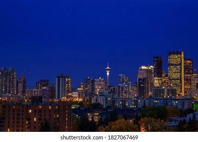 Dark sky over an illuminated downtown Calgary