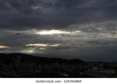 dark sky rainy heavy clowds grey sun rays