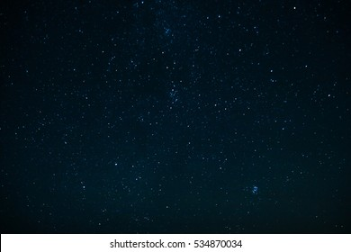 The dark sky with stars and constellations