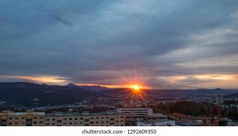 Dark sky sunset over industrial cityscape city, Usti nad Labem