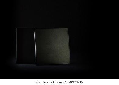 dark small plastic box on a black background in the dark