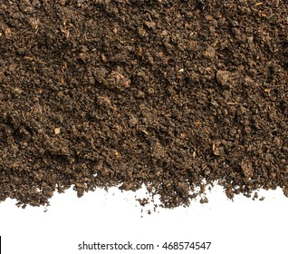 Dark Soil on White Background.Top View of a soil. Close Up Macro View with Text or Image Space