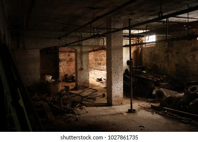 Dark spooky basement of an abandoned building. Natural light.