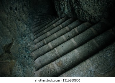 dark stairs dungeon cave path way underground in twilight lighting environment , horror concept photography