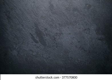 Dark stone background - Shutterstock ID 377570800