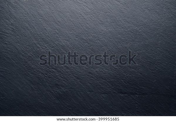 Dark stone background.