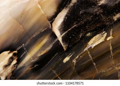 Dark stone texture. Cracks on surface.