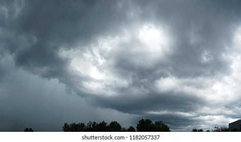 dark storm cloud on the sky above trees