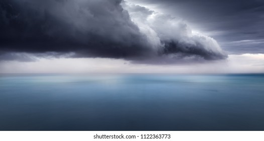 A dark storm cloud over the ocean