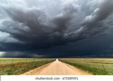 Dark storm clouds and dirt road