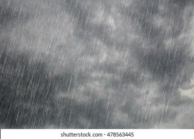 dark storm clouds with falling rain