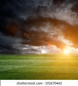 Dark storm clouds over a football field
