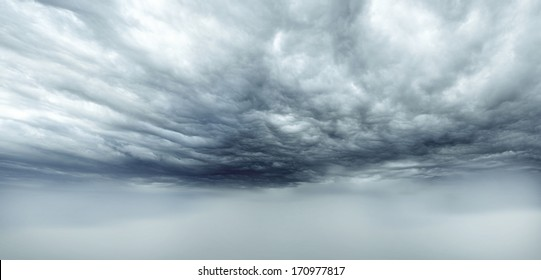 Dark storm clouds sky. Copy space below