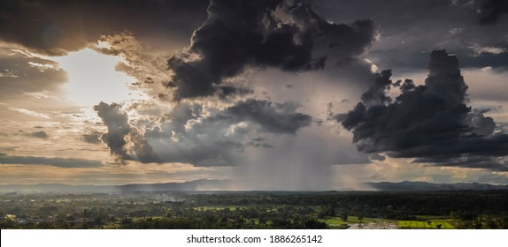 Dark storm clouds sky. Copy space below, a thunderstorm with the rain, nature Background, Dark ominous grey storm clouds. Dramatic sky ray.