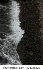 Dark and stormy beach, Mykines, Faroe Islands