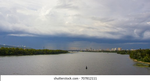 Dark stormy clouds over the city background