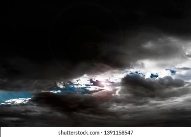 Dark stormy cloudy sky background, dramatic nature storm black clouds is covering lights and sky before big thunder rain, bad weather