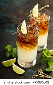 Dark and stormy cocktail with ginger ale and rum