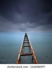 dark stormy day on a pier of santa magdelana