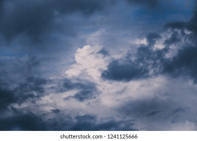 Dark stormy dramatic clouds in sky. For background and wallpaper