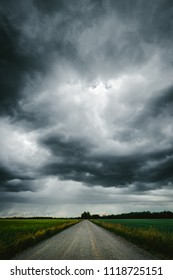 Dark stormy sky above the country road