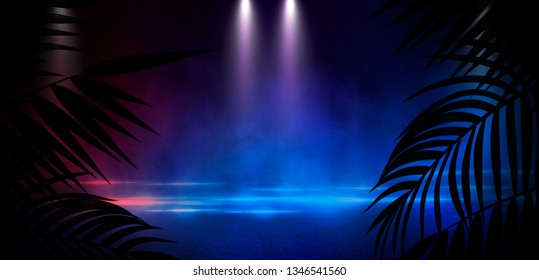 Dark street with neon lights and spotlights. Abstract rays and lines of light in the dark. Light pyramid, a triangle in the center. Reflection in the wet pavement of city lights.  tropical leaves.