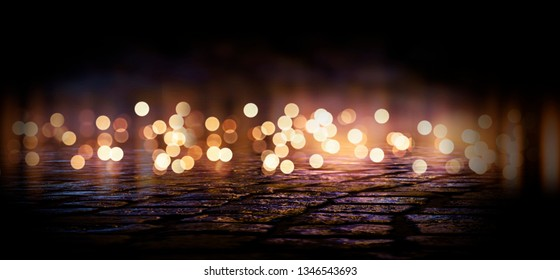 Dark street of the night city. Abstract bokeh light. Reflection on the wet asphalt, the lights of the night city. Dark background with abstract bokeh, rays of light.