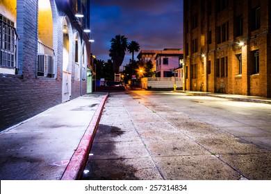 A dark street at night, in Venice Beach, Los Angeles, California.