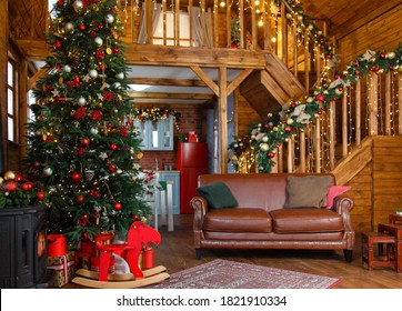 Dark Stylish Christmas interior with a soft leather sofa in wooden chalet. Comfort home.