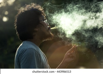 Dark and sullen shot of a man smoking