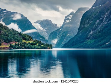 Dark summer view of Lovatnet lake, municipality of Stryn, Sogn og Fjordane county, Norway. Dramatic evening scene of Norway. Beauty of nature concept background.
