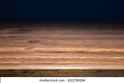 a dark tabletop against a black background