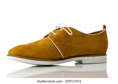 Dark tangerine suede shoe with shoelace on white background.