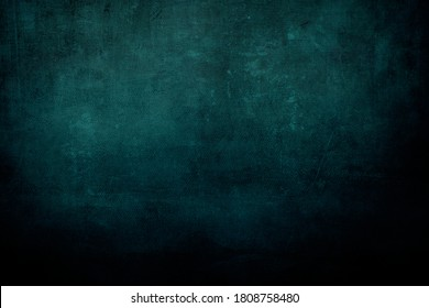Dark teal canvas grungy background or texture