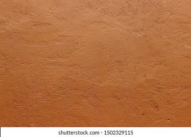 Dark terracotta plaster rough wall texture background