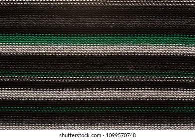 Dark textile texture with light line pattern