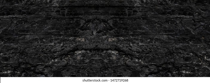 Dark texture of black color.The surface of natural black hard coal. Best grade of metallurgical anthracite coals. Black background.