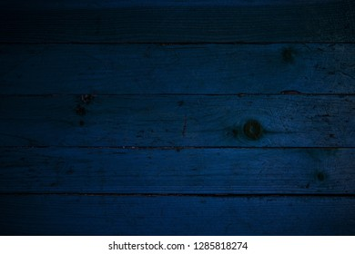 dark texture blue wooden boards with slits and natural patterns background for design