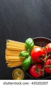 dark texture of Italian pasta with various ingredients