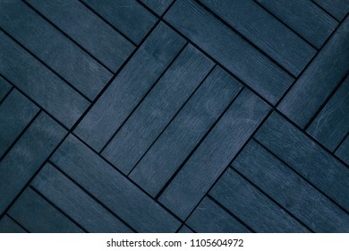 A dark texture of squares with crevices