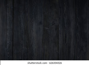 the dark texture of wooden boards from Siberian larch