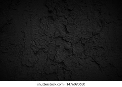 Dark textured and painted wall. Black wall background.